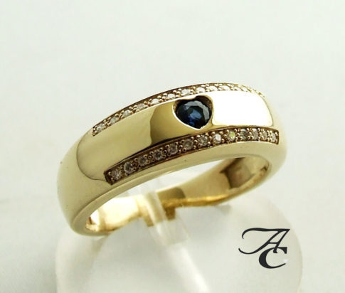 Gouden harten ring met diamanten en saffieren