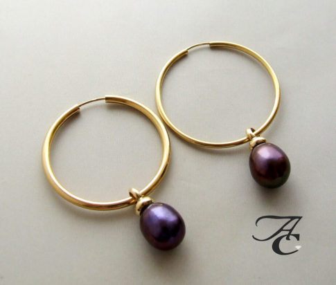 Gouden oorbellen met hangers