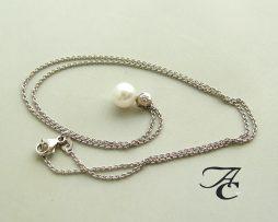 Gouden collier en hanger met parel en diamant