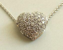 Gouden collier en hart met diamanten