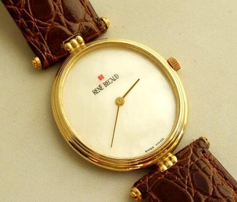 Gouden René Becaud horloge
