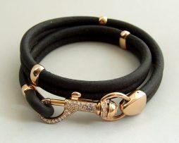 Gouden en leren armband met diamant