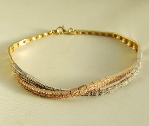 14 karaat geel-, wit en rosé gouden armband met zirkonia