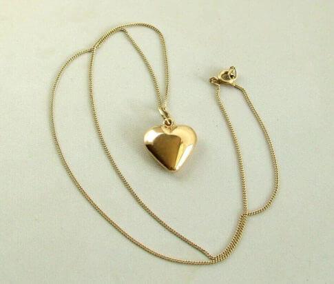 Geel gouden collier met harten hanger
