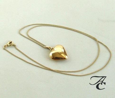gouden collier met harten hanger