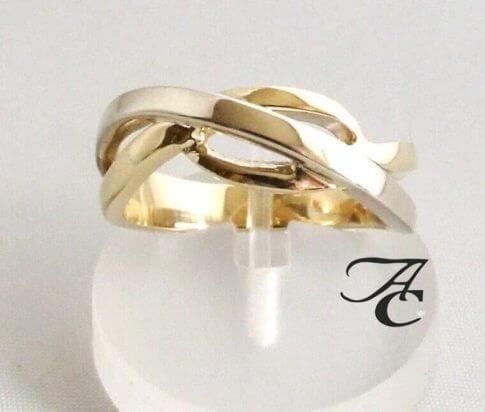 Gevlochten gouden bicolor ring