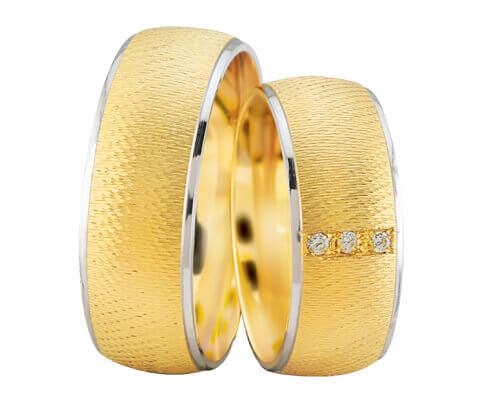 Gouden trouwringen met wit gouden rand