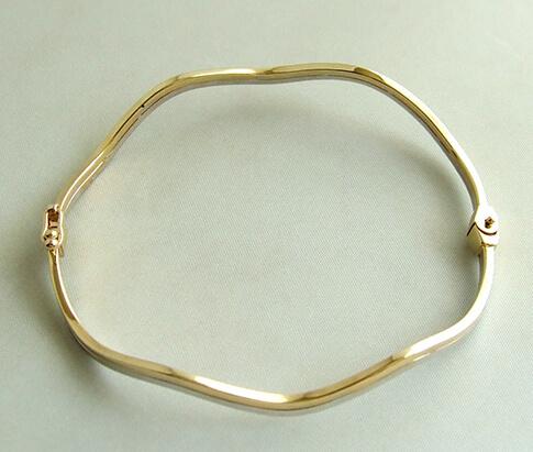 Gouden bicolor slavenarmband golvend model