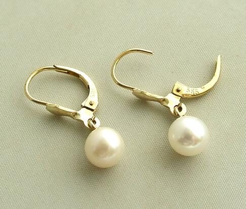 Geel gouden oorbellen met parel